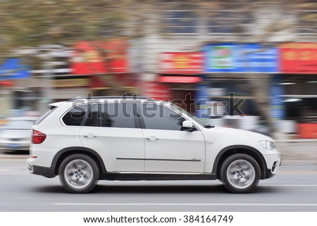 YIWU-CHINA-JANUARY 20, 2016. BMW X5 3.5i on the road. BMW sales will be hit in 2016 by cut-throat competition, slowing Chinese economy and government crackdown on graft and conspicuous consumption. - stock photo