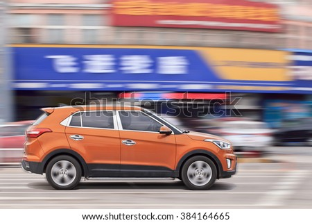 YIWU-CHINA-JANUARY 26, 2016. Orange Hyundai IX 25 compact SUV. Hyundai car sales in China increased with 11.2 percent in 2015, keeping an upward trend for the succeeded top car-maker from South Korea. - stock photo