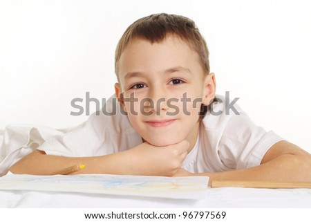 yjinking boy on white floor with a pen - stock photo