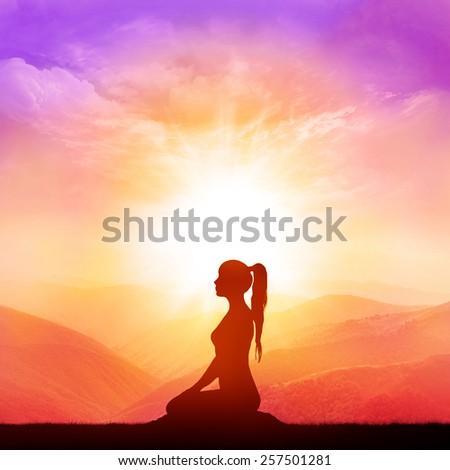 Yoga and meditation. Woman silhouette. - stock photo