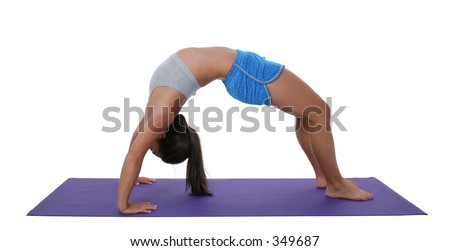 Yoga Backbend. Beautiful dark haired tan teen girl in workout clothes on purple mat.