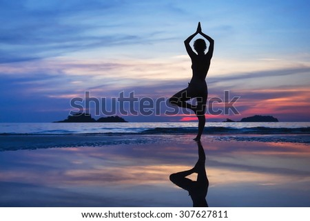 yoga background, beautiful silhouette of the woman - stock photo