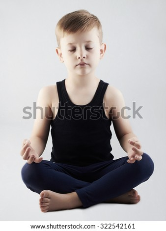 Yoga boy.child in the lotus position.children meditation and relaxation for health - stock photo