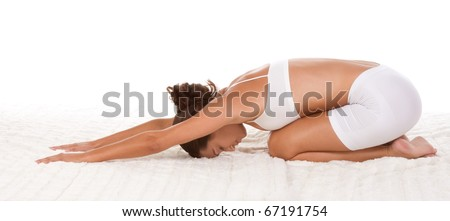 """yoga """"Child's Pose"""" - female in sport clothes performing exercise - stock photo"""