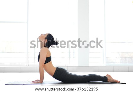 Yoga concept. Young attractive woman does exercises, close up - stock photo