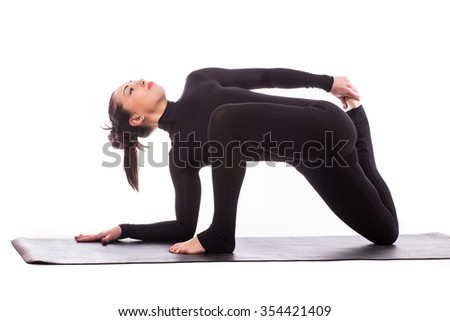 Yoga concept/Young beautiful yoga female posing on a studio background