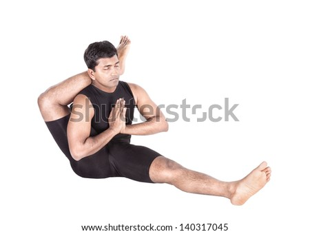 Yoga eka pada shirshasana foot behind the head pose by Indian man in black costume isolated at white background