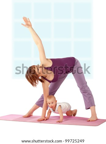 Yoga exercise / Mother with her baby practicing yoga