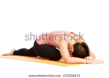 Yoga exercises in front of white background - stock photo