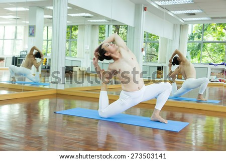Yoga exercises in the gym. - stock photo