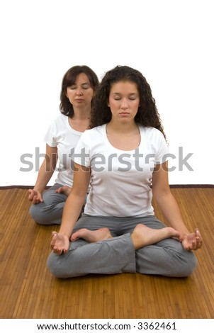 Yoga for different age groups (mother and daughter doing yoga) - stock photo
