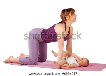 Yoga for woman and child / Mother and her baby doing yoga exercise