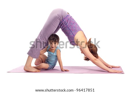 Yoga for woman and child / Mother and her son doing yoga exercise