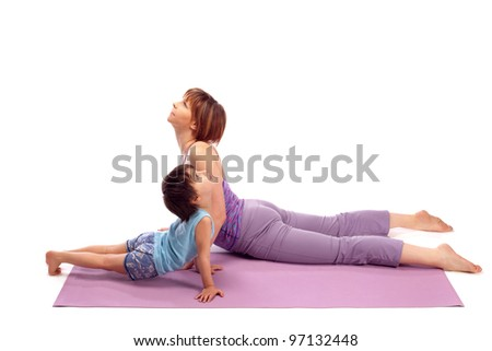 Yoga for woman and child / Mother and her son doing yoga exercise.