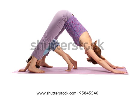 Yoga for woman and child / Mother and the child doing yoga exercise