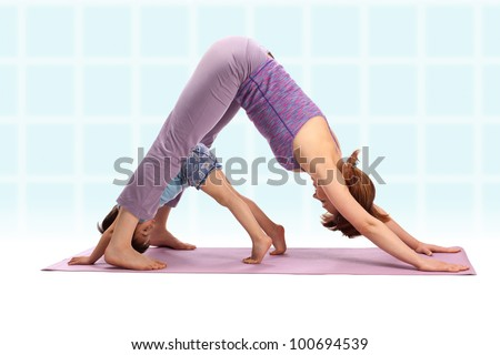 Yoga for woman and child / Mother with her son doing yoga exercise