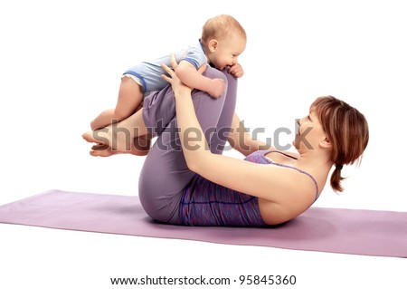 Yoga for woman and child / Mother with the baby boy doing Yoga exercises - stock photo