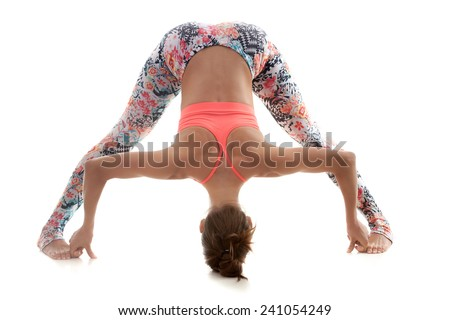 Yoga girl on white background leans forward while stretching muscles - stock photo
