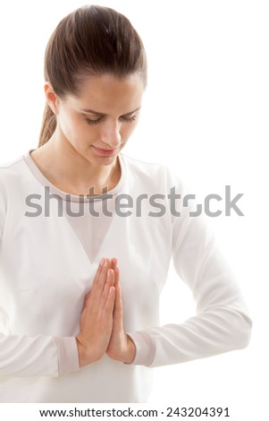 Yoga girl on white background with palms touching in a gesture of namaste - stock photo