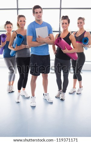 Yoga group in gym - stock photo