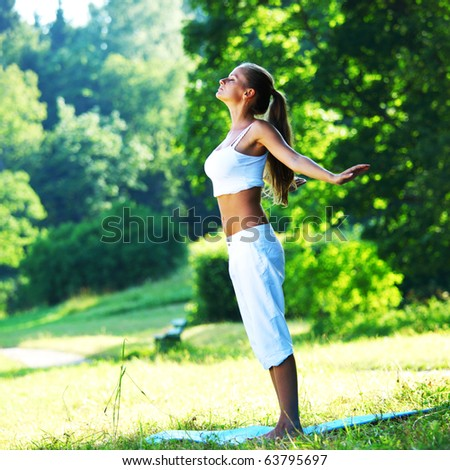 yoga in park - stock photo