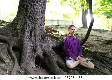 Yoga in the forest - stock photo