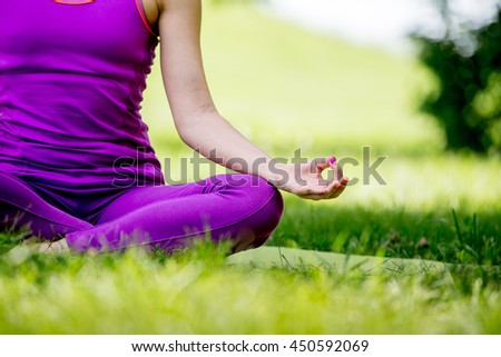 Yoga in the park. woman meditating on nature