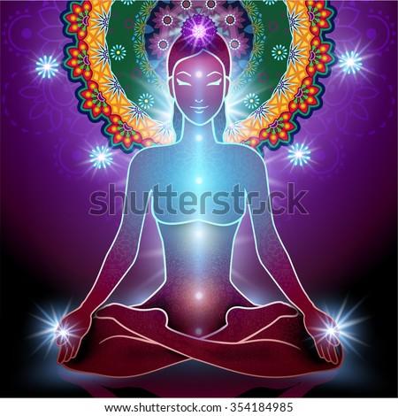 Yoga Lotus Position and Chakra and light - stock photo