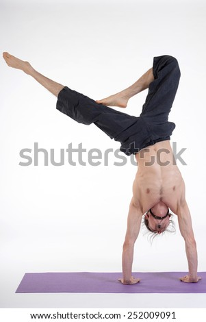 Yoga man isolated in photo studio on white background. - stock photo