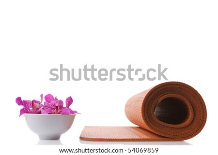 yoga mat and orchid in bowl - stock photo