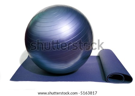 yoga mat and pilates ball isolated on white background - stock photo