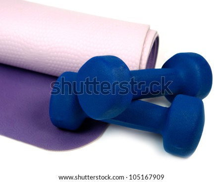 Yoga mat and set of two pounds - stock photo
