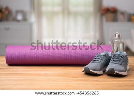 yoga mat and sport shoe - stock photo