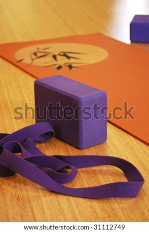 Yoga mat, block and strap - stock photo