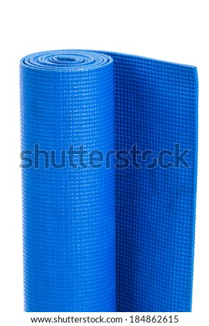 Yoga mat isolated on a white background. Blue gymnastic mat. - stock photo