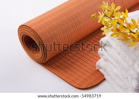 Yoga Mat with Towel and Orchid - stock photo