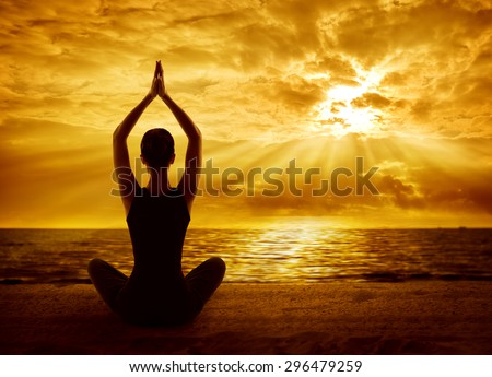Yoga Meditation Concept, Woman Silhouette Meditating in Healthy Pose, Back View on Sun Light Rays - stock photo