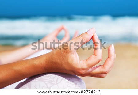 Yoga meditation on the beach, healthy female in peace, soul and mind zen balance concept - stock photo