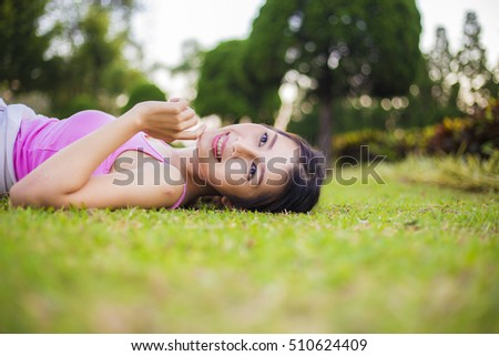 Yoga, Morning the Asia women beautiful model health care show yoga, sleep on the grass ,