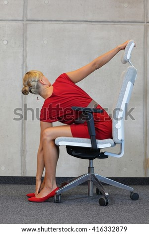 yoga on chair in office - business woman exercising, back view - stock photo