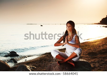 yoga on sea - stock photo