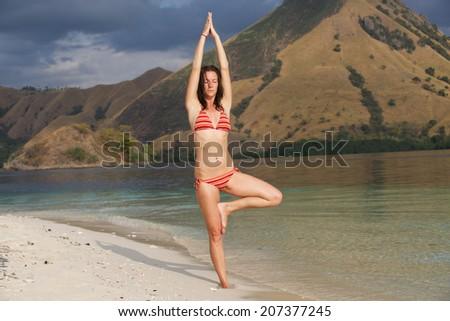 Yoga on the beach - stock photo