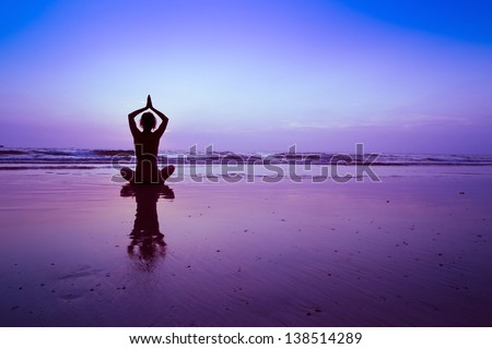 yoga on the beach, meditation - stock photo