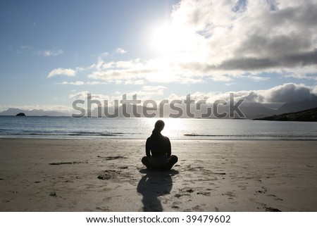 yoga on the beach silhouette, lofoten norway - stock photo
