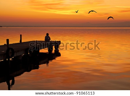 Yoga on the Lake - stock photo