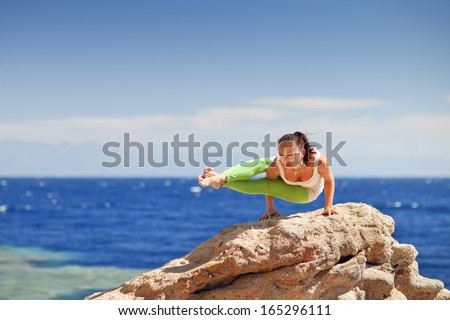 yoga on the mountain by the sea - stock photo
