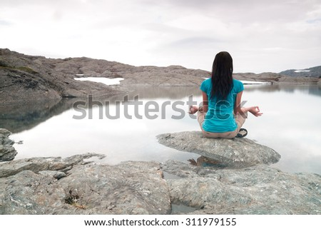 yoga on the shore of a mountain lake