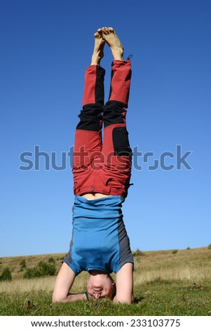 Yoga outdoors in Carpathians mountains - stock photo