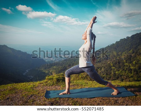 woman doing yoga asana natarajasana lord stock photo