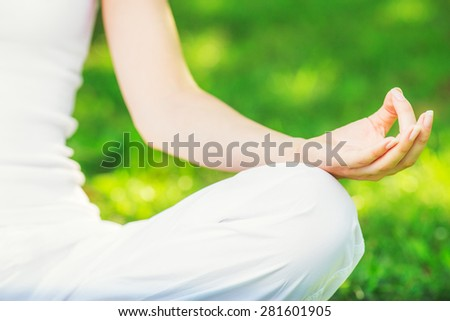 Yoga outdoors. Yoga gesture. Concept of healthy lifestyle and relaxation. - stock photo